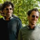 (L-r. in foreground) Writer/directors Joel & Ethan Coen on the set of their new film A Serious Man, a Focus Features release.