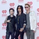 Musicians DJ Ashba, Nikki Sixx and James Michael of Sixx:A.M. attend the 2014 iHeartRadio Music Festival at the MGM Grand Garden Arena on September 19, 2014 in Las Vegas, Nevada