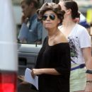 "Setton wears a short blue dress as she walks onto the New York City set of ""Gossip Girl"""