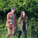 Lily Collins and Charlie McDowell take their daily walk