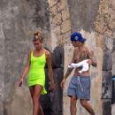 Hailey Baldwin in Black Bikini in Italy adds