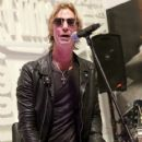 Duff McKagan makes an appearance at the Fender booth during the 2019 NAMM Show at the Anaheim Convention Center on January 26, 2019 in Anaheim, California - 417 x 600