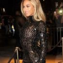 Beyonce dazzles in risque see-through dress and thigh-skimming boots at party to celebrate smash album