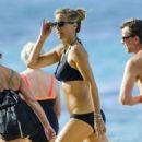 Tea Leoni in Black Bikini on the beach in Barbados - 454 x 556
