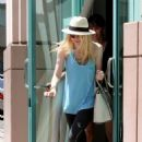 Hurrying to her awaiting vehicle, Dakota Fanning hastily left the gym in Hollywood yesterday (August 10)