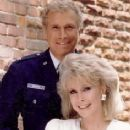 Wayne Rogers and Barbara Eden