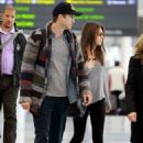 Ashton Kutcher and Mila Kunis at Pearson International Airport in Toronto (September 28)