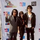 Musician Gene Simmons, Alex Esso and Nick Simmons arrive at the 2011 VH1 Do Something Awards at the Hollywood Palladium on August 14, 2011 in Hollywood, California.