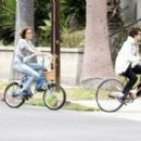 Isabel Lucas Riding Her Bicycle With A Friend