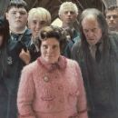 "(L-r) KATIE LEUNG as Cho Chang, JAMIE WAYLETT as Vincent Crabbe, TOM FELTON as Draco Malfoy, IMELDA STAUNTON as Dolores Umbridge and DAVID BRADLEY as Argus Filch in Warner Bros. Pictures' fantasy 'Harry Potter and the Order of the Phoenix."" - 454 x 191"