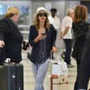 Jessica Alba is seen arriving at JFK airport in NY (June 18, 2014)