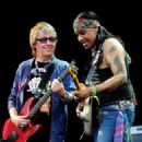 Bill Wyman performs with Micki Free during day 2 of the Hard Rock Calling festival held in Hyde Park on June 26, 2010 in London, England