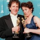 Geoffrey Rush and Frances McDormand At The 69th Annual Academy Awards (1997) - 405 x 364