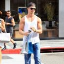 Derek Hough enjoys some solo shopping in Beverly Hills, California on September 9, 2015