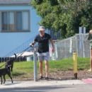 Joel Kinnaman and Kelly Gale take their dogs to the dog park in Venice Beach - 454 x 303