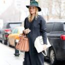 Rosie Huntington-Whiteley was seen holding her pregnant belly while shopping at ABC Carpet & Home store in New York City, New York on April 6, 2017 - 397 x 600