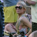 Paris Hilton enjoyed time by the pool at her Miami, Florida hotel on March