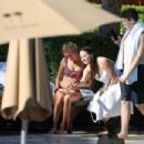 Hailey Bieber in Bikini relaxes by the pool in Miami