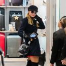 Paris Hilton at Heathrow Airport Terminal 3 in London