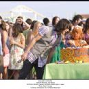MITCHEL MUSSO (center) and MOISES ARIAS (right, in cake) in Walt Disney Studios Motion Pictures' Hannah Montana: The Movie. Photo: Sam Emerson Hannah Montana The Movie '© Disney Enterprises, Inc. All Rights Reserved.'