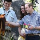Catherine, Duchess of Cambridge holds Prince George of Cambridge as they visit the Bilby Enclosure at Taronga Zoo on April 20, 2014 in Sydney, Australia