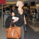 Malin Akerman departing on a flight at LAX airport in Los Angeles, California on January 26, 2015 - 392 x 600