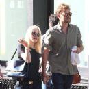 A smitten looking Dakota Fanning and her boyfriend Jamie Strachan go hand in hand for a stroll around New York City - 336 x 594