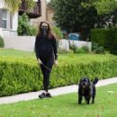 Troian Bellisario – Out for a walk with her dog in Los Angeles - 454 x 445