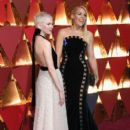 Michelle Williams and Busy Phillips At the 89th Annual Academy Awards - Arrivals (2017)