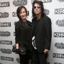 Alice Cooper and Sheryl Goddard attends the Relentless Energy Drink Kerrang! Awards at the Troxy on June 11, 2015 in London, England. - 402 x 600