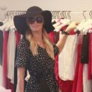 Paris Hilton seen wearing a black hat and a heart print dress while enjoying a shopping trip with some girlfriends in Malibu