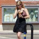 Emma Roberts in Black Mini Dress at a Starbucks in Brentwood