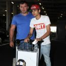 One Direction's Niall Horan and Zayn Malik arrive at Heathrow Airport from Los Angeles on September 9, 2012