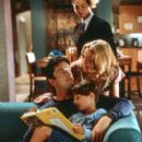 Ben (Benjamin Bratt) looks on at the unconventional family of Robert (Rupert Everett), Sam (Malcolm Stumpf) and Abbie (Madonna) in Paramount's The Next Best Thing - 2000 - 266 x 400
