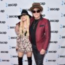 Musicians Orianthi and Richie Sambora attend 2016 Billboard Power 100 Celebration at Bouchon Beverly Hills on February 12, 2016 in Beverly Hills, California.
