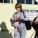 Alice Eve Debuts a new haircut – Leaves a gym in LA - 454 x 517