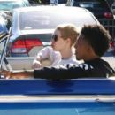Nick Young and his rapper girlfriend Iggy Azelea ride in style to grab some Chick-fil-A in Los Angeles California on December 23, 2014 - 454 x 298