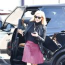 Reese Witherspoon – Wears a pleated purple skirt at her office with her bulldog