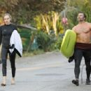 Cara Delevingne shows off her abs after surfing in Malibu