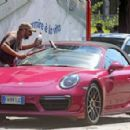 Michelle Hunziker – Spotted at her pink porsche in Milan - 454 x 295