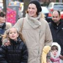 Milla Jovovich Bundles Up In Toronto With Her Family