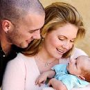 Mark Wilkerson and Melissa Joan Hart and their baby