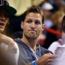 Juan Pablo Galavis attends a Miami Heat basketball game with friends on December 17, 2014 in Miami, Florida - 454 x 577