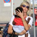 Charlize Theron- at a Cretan airport with her kids August 2016