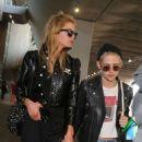 Kristen Stewart and Stella Maxwell at Charles de Gaulle airport in Paris - 454 x 637