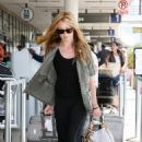 Cat Deeley Laughs As She Realizes She Has Tried To Check Into The Wrong Airline In Los Angeles