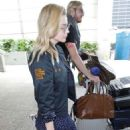 Chloe Moretz in Mini Dress at LAX Airport in Los Angeles