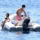 Zoey Deutch in Black Bikini on holiday in Ischia