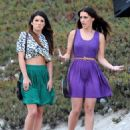 Shenae Grimes and Jessica Lowndes strolling down the beach on the set of