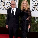 Still going strong! Jerry Hall, 59, hits the Golden Globes red carpet on the arm of 84-year-old Rupert Murdoch - three months after it was revealed they are dating - 11 Jan 2016 - 454 x 685